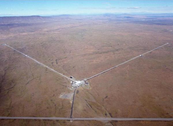 Has LIGO Seen Galaxy-Warped Gravitational Waves?