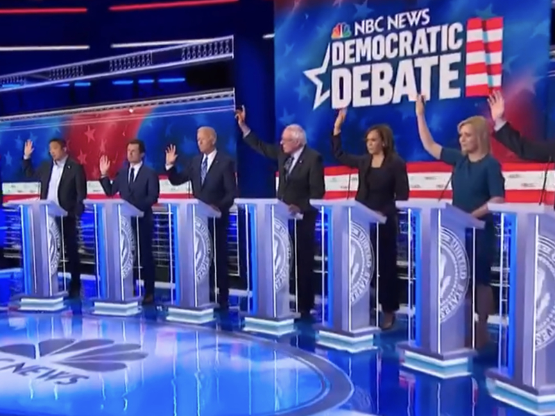 Image result for democrats raising hands at debate