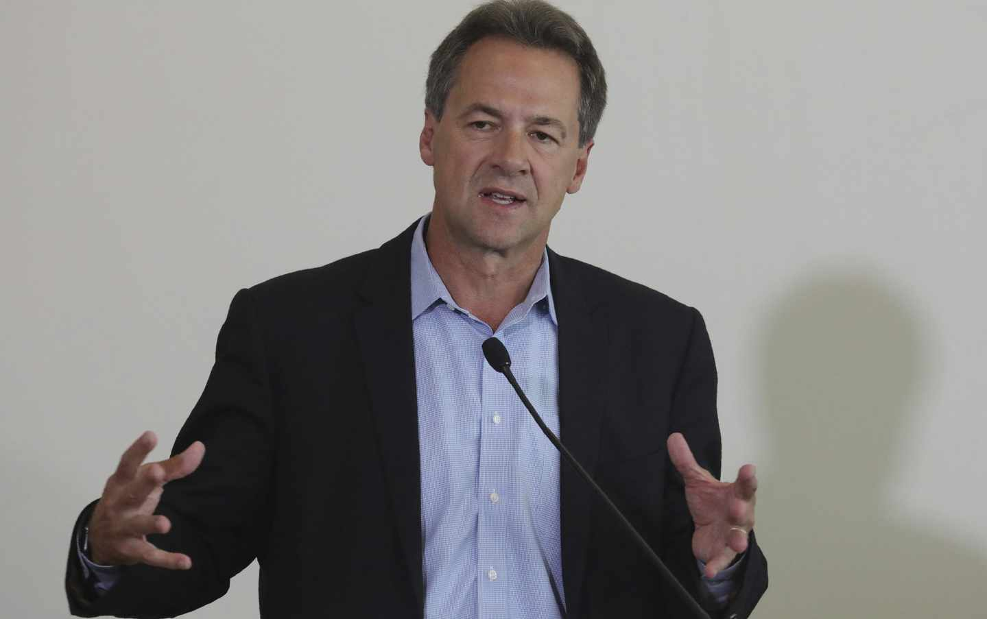 Bullock Straddles Two Worlds on Gun Control Laws