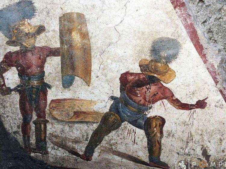 Archaeologists Unearth Bloody Gladiator Fresco in Pompeii