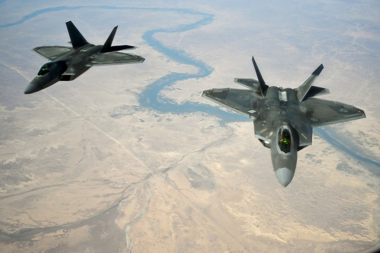 Air Force Arms F-22s With New Weapons, Changing Attack Tactics