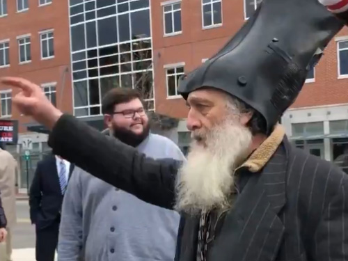 "NH Primary Mainstay Vermin Supreme Blocks Buttigieg's Car Chanting ""Boot Head Head"""